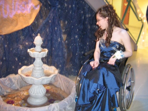 Young adult in a prom dress and wheelchair