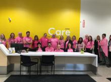 Employees of Motion Hamilton in their Pink Shirts!
